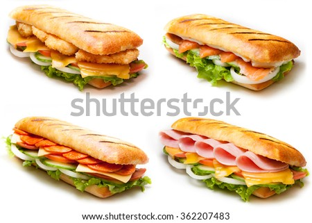 Set of pannini sandwiches: salmon, ham, chicken, salami - stock photo