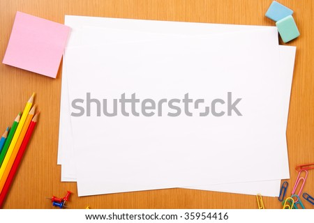 Set of pencils, erasers, post-its and other useful supplies for the school. There is a centered blank sheet for text writing - stock photo
