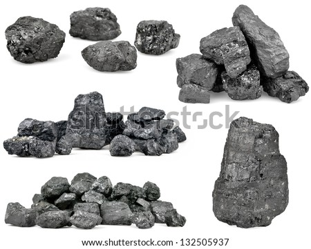 Set of piles of coal isolated on white background. - stock photo