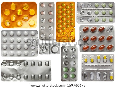 Set of pills in blister isolated against white background  - stock photo