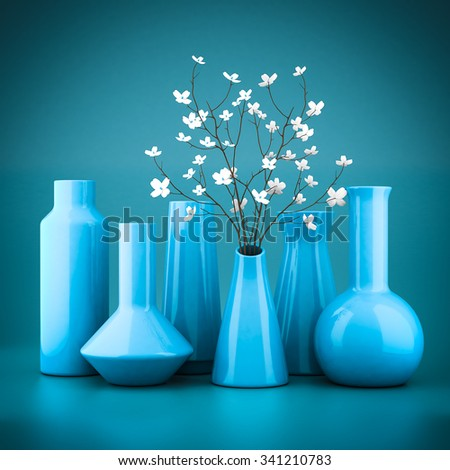 set of porcelain vases on a blue background - stock photo