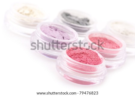 Set of powder eye shadows in jars on white background. - stock photo