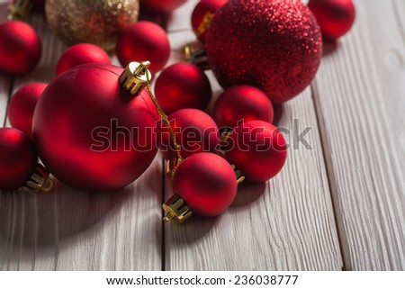 set of red christmas balls on white boards - stock photo