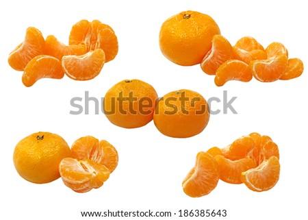 Set of ripe tangerine and tangerine semgents isolated on white background. - stock photo