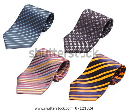 set of rolled up neck ties isolated on white background - stock photo