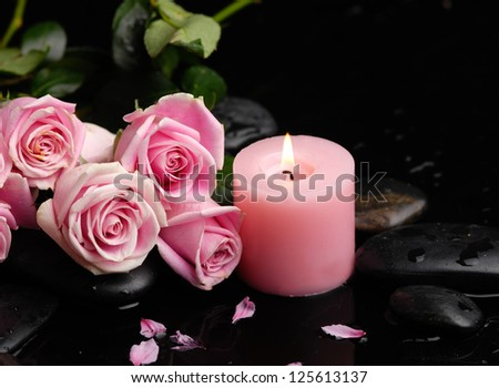 Set of roses and bamboo leaf with therapy stones - stock photo