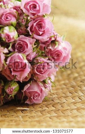 Set of Roses Bouquet on wickers abstract background - stock photo