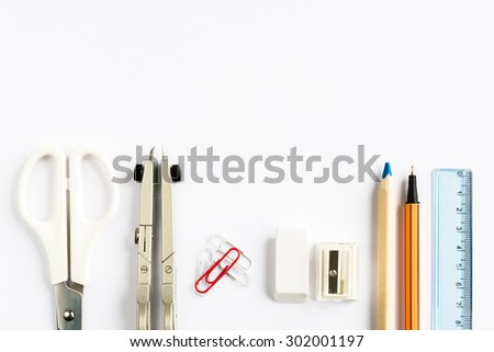 Set of school stationery on white background from above - stock photo