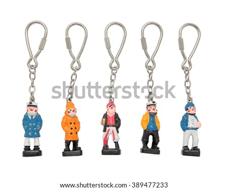 Set of seaman figures key trinkets with stainless chain and key ring isolated on white - stock photo