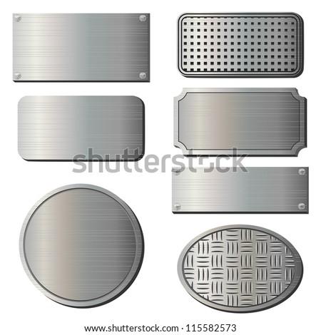 Set of seven gray metal plates over white - stock photo