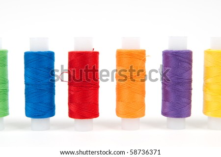 Set of sewing threads on white backgrounds - stock photo