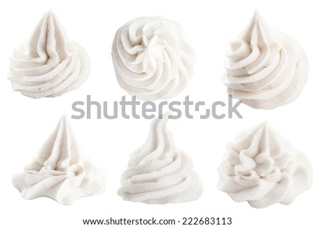 Set of six different white decorative swirling toppings for dessert isolated on white depicting whipped cream, ice cream or frozen yogurt - stock photo