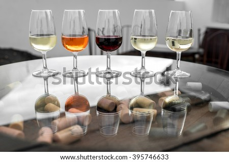 Set of six different wines in wineglasses on the table for degustation - stock photo
