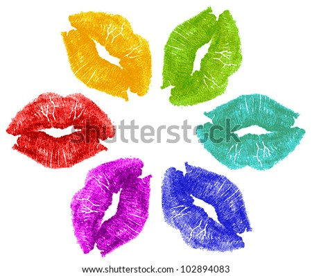 Set of six lipstick kisses in red, yellow, green, cyan, blue, purple in flower formation pattern isolated on white background. - stock photo