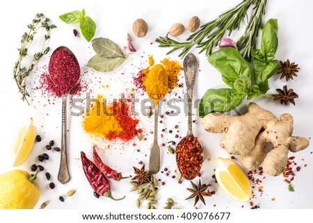 set of spices, herbs and vegetables on a white background - stock photo