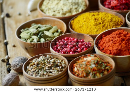 Set of spices on wooden table - stock photo