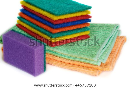 Set of sponges of various color on white background and napkins - stock photo