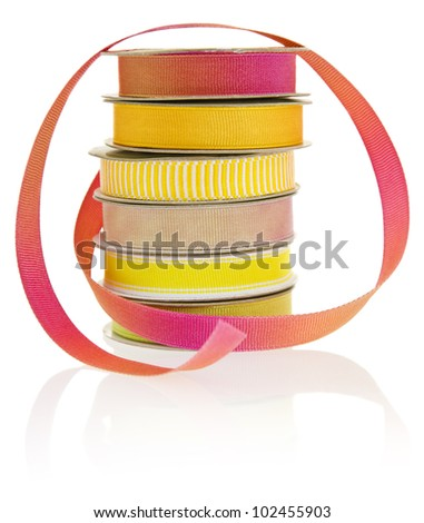 Set of 6 spools of ribbon, isolated on a white background. - stock photo