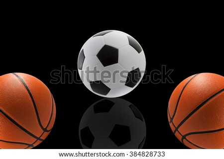 Set of sport balls, basketball and football on black background - stock photo