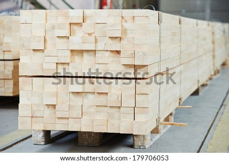 Set of Stacked wood pine timber for construction buildings and furniture production - stock photo