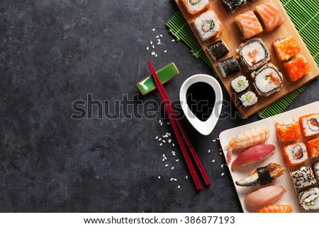 Set of sushi and maki on stone table. Top view with copy space - stock photo