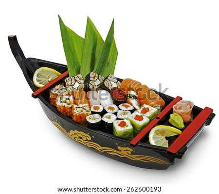 Set of sushi and rolls on dish rook. Isolated on white background - stock photo