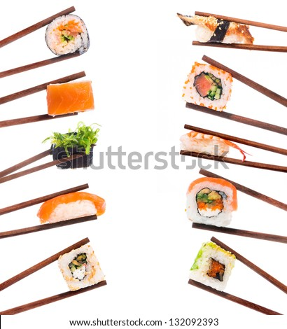 Set of sushi with chopsticks shot on white - stock photo