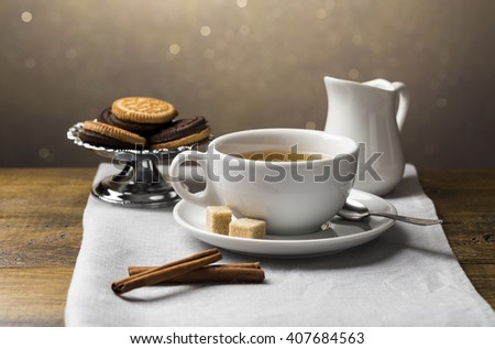 Set of tea cups with saucer and milk jug - stock photo