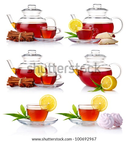 Set of teapot with black tea isolated on white background - stock photo