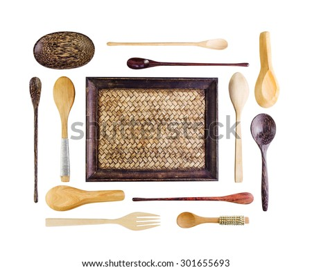 Set of the wooden kitchen utensils on a white table background - stock photo