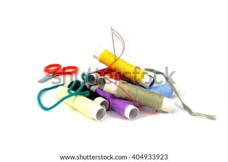 Set of thread, scissors, tape and a needle on a white background - stock photo