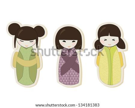 Set of three japanese kokeshi dolls in colorful kimonos - stock photo