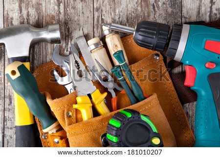 set of tools in tool box on a wooden background - stock photo