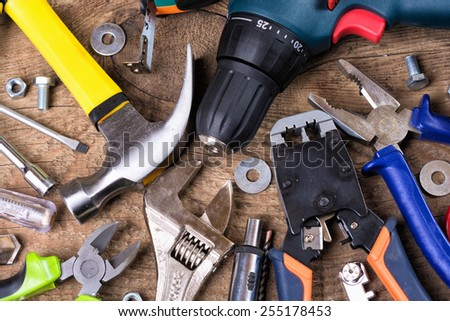 Set of tools over a wood background - stock photo