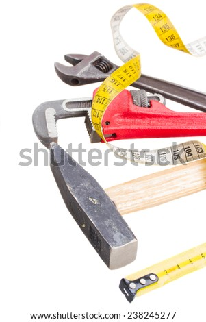 set of tools with hammer and ajustment spanners isolated on white background - stock photo