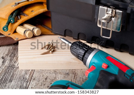 set of tools wooden background - stock photo