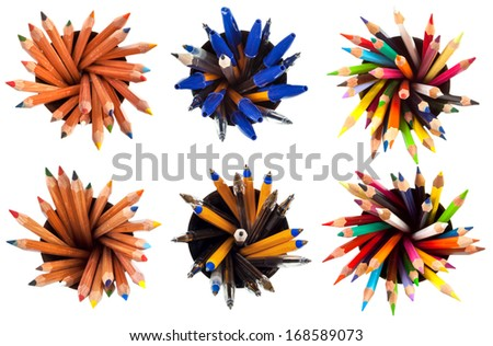 set of top view of pens and pencils with white background - stock photo