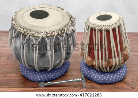 set of traditional tabla drums on wooden surface - stock photo