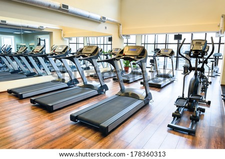 Set of treadmills staying in line in the gym - stock photo