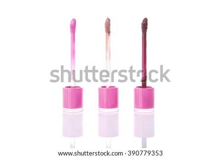Set of trendy matte liquid lipsticks, isolated on white background  - stock photo