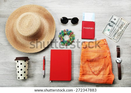 Set of trip stuff on wooden background - stock photo