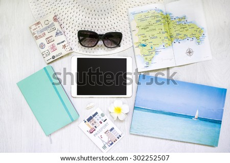 Set of trip stuff on wooden background, Preparing for travel, digital gadgets, Summer  Caribbean vacation,top view,  phone, tablet, glasses, Passport, turquoise, notebook - stock photo