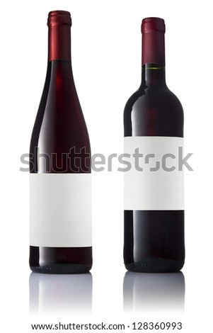 Set of two green bottles with labels of red wine isolated on white background. - stock photo