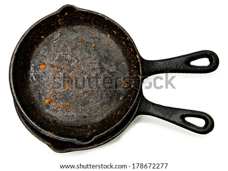 Set of Two Rusty Cast Iron Skillets over white. - stock photo