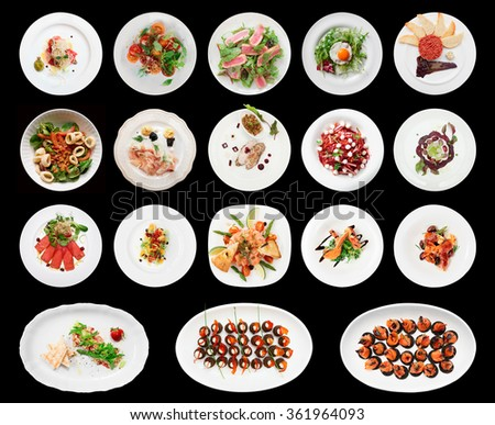Set of various appetizers on black background - stock photo