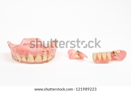 set of very old dentures - stock photo