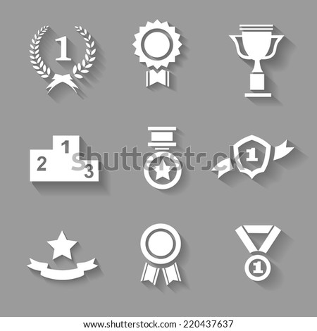 Set of white  award  success and victory icons with trophies  stars  cups  ribbons  rosettes  medals medallions  wreath and a podium on grey - stock photo