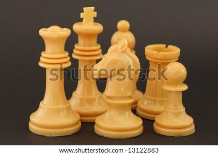 Set of white chess figures on dark background - stock photo