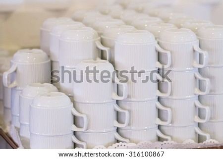Set of white coffee cups on the tray in the hotel restaurant - stock photo