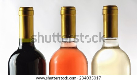 Set of white, rose, and red wine bottles  - stock photo